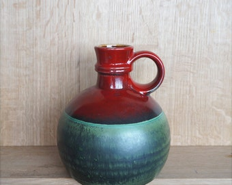 Midcentury ceramic vase in great condition by Steuler Germany 308/20, deep red with beautiful green and ochre inside. Steady pitcher design