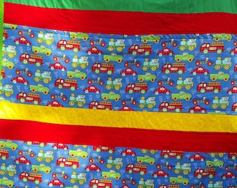 Baby quilt with cars, trains and trucks