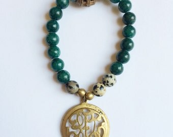 green & brass scroll bracelet