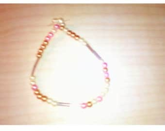 Gold/pink like braclet