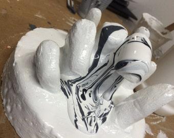 Melting hand sculpture