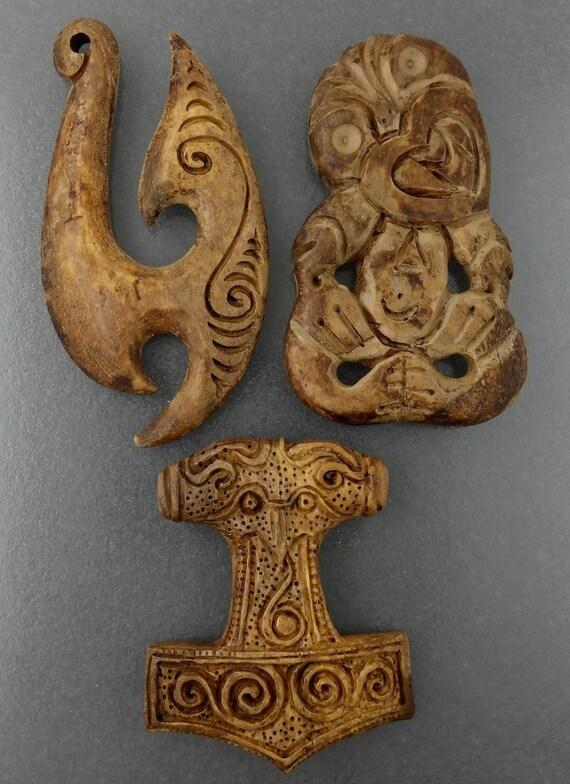 Maori hand carved bone carvings tiki fish hook