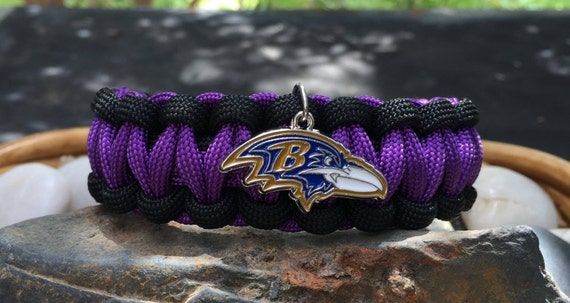 Baltimore Ravens  Paracord Bracelet, with the Ravens logo charm, and a stainless steel metal buckle