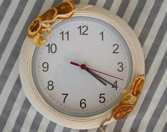Time decorated ... clock decorated with dried fruit and kindling marini