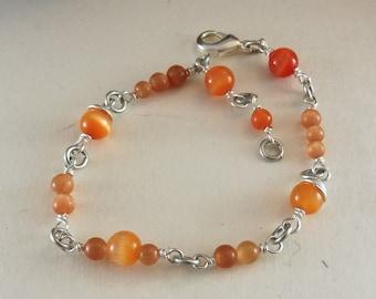 "Bracelet with Orange Cat Eye-Beads - ""Applejack"""