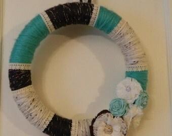Sea foam green, cream, and brown yarn wreath, with hand-made flowers