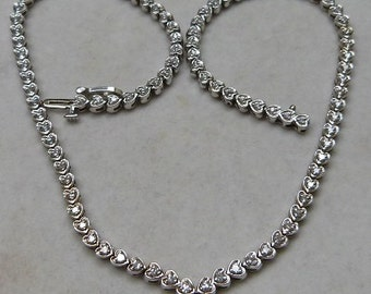 14 karat white gold and diamond necklace