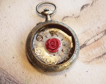 """Romantic steampunk pendant """" the time has stopped"""" silverplated  watchcase with a coralrose, a dial  gears in resin"""
