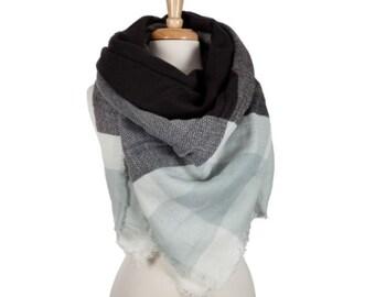 Light blue, black and white plaid blanket scarf. 100% acrylic.