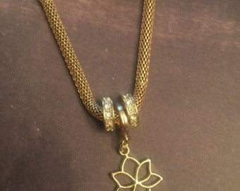 Gold plated charm bracelet with lotus charm