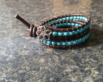 Leather  beaded wrap bracelet with flower button