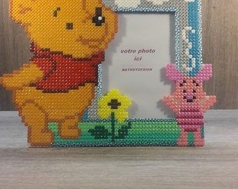 pixel art inspired by Winnie l Pooh and piglet