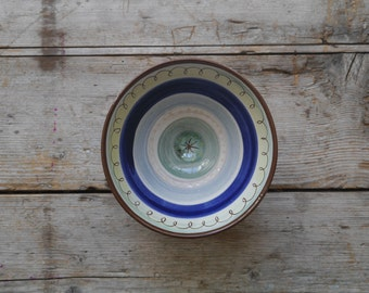 Hand thrown and decorated earthenware bowl