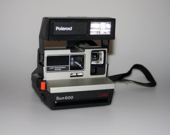 Polaroid Sun 600 LMS Instant Camera with Case and Manual in Box Tested & Working