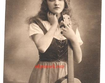 Girl vintage guitar folk music sepia rppc photo postcard moody dark