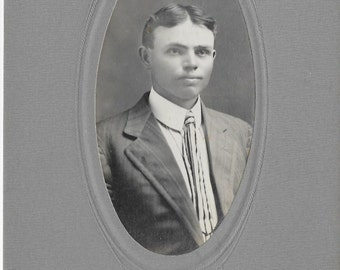 Antique photo card of a handsome young man