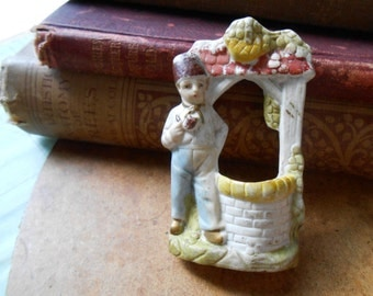 man with fez smoking a pipe by well railroad mini - antique doll made in germany