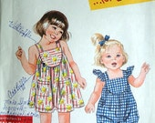 "Simplicity 9557 ""It's So Easy"" For Kids Sewing Pattern, Toddlers' Romper and Dress, Size 1/2-1-2-3-4, Uncut FF"