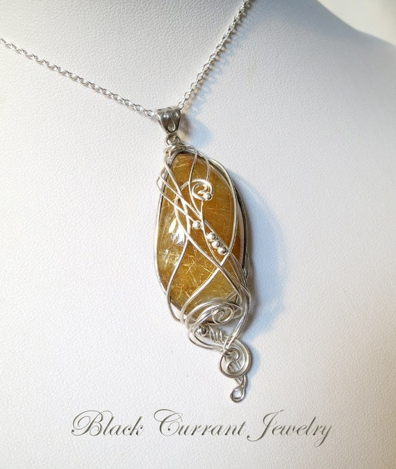 Quartz With Gold Inclusions : Golden rutilated quartz with gold inclusions and sterling