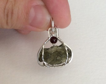 Moldavite sterling silver wire wrapped pendant with garnet reversable