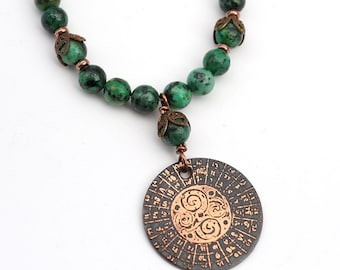 African turquoise spiral necklace with blue green semiprecious stone beads, etched metal medieval illuminated manuscript, 19 1/4 inches long