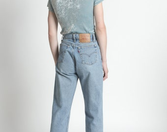 Vintage 90s Levis Light Wash 560 Zipper Fly Jeans | 4