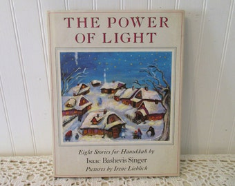 The Power of Light, Eight Stories for Hanukkah by Isaac Bashevis Singer, Pictures by Irene Lieblich HC DJ signed First Edition (c) 1980 book