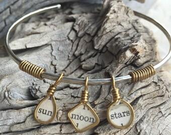 brass wire wrapped charm nickel silver wire bangle bracelet jewelry resin bezel inspirational sayings sun moon stars mixed media jewelry