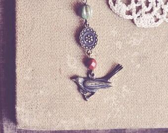 SALE earthy beaded bird necklace.