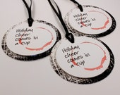 Set of 3- Holiday Cheer comes in a Cup- Wine tag with distressed background- Spilled Wine red with Black Ribbon
