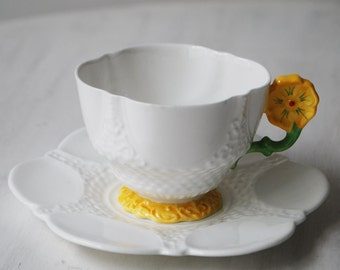 Aynsley Teacup and Saucer, White with Flower Handle