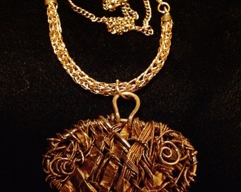 woven copper pendent with viking knit chain