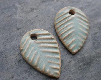 Leaves- handmade artisan ceramic leaf charm earrinb bead matched pair green 1871