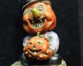 Vintage Pumpkin Head Scarecrow holding Jack-o-Lantern Resin Miniature Figurine ~ Primitive Halloween Harvest Home Decor