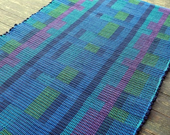 Handwoven rug in blues, greens and purple