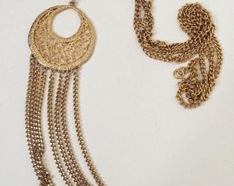 Long statement detailed fringe necklace