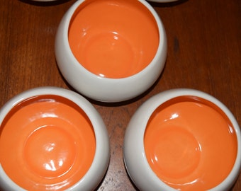 Three fab vintage heavy white with orange interior colored bowls