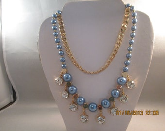 2 Strand Necklace with a gold tone chain; Blue Pearled and Gold Beads and Clear Crystal Like Dangles