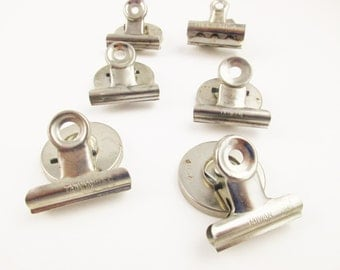 "Six Metal Magnets - 1 1/2"" Round With Clips  - One 'Jiffy' - Remaining Made in Taiwan - Six Metal Magnets"