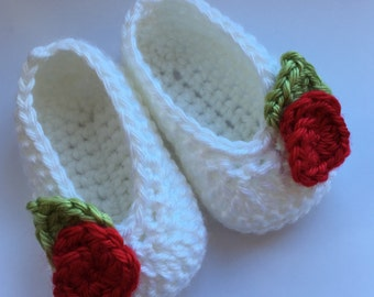 Crochet baby shoes for babies age 0-3 months. White with red flower decoration
