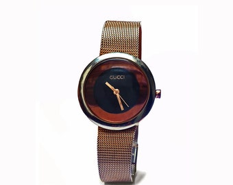 Gucci watch with mesh bracelet wristband