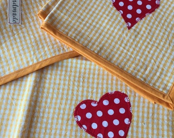Yellow checkered placemat.