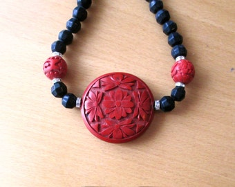 Carved Cinnabar Necklace, Round Cinnabar Pendant and Cinnabar and Glass Bead Necklace