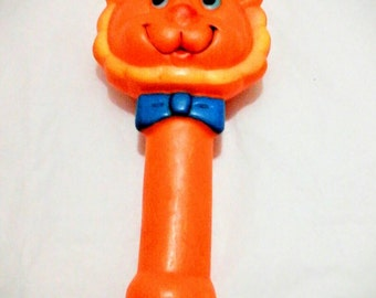 1970's squeaky toy orange lion vinyl