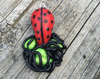 LadyBug inspired Octopus/Squid Holding Leaves Polymer Clay Charm
