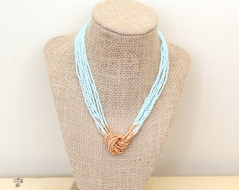 Aquamarine and Copper Seed Bead Necklace. Knotted Necklace. Knot necklace. Beaded Necklace. Blue and Gold Necklace. Short Necklace.