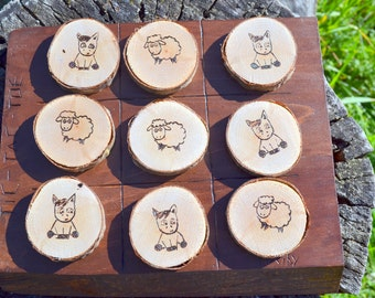 Game of tic tac toe rustic in the pyrography on wood horse and sheep washers