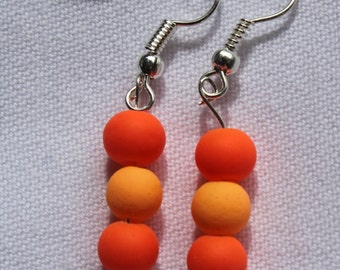Earrings with orange beads