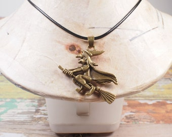 Witch pendant. Witch with broom. halloween jewelry. Pendant in bronze. Halloween pendant.