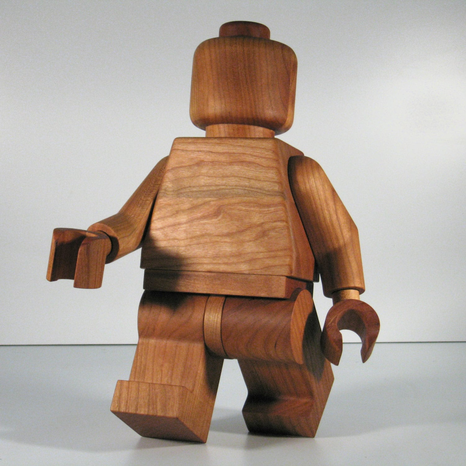 large wooden lego man sculpture cherry. Black Bedroom Furniture Sets. Home Design Ideas